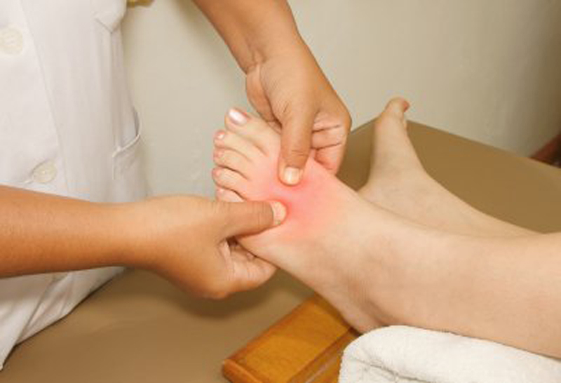 palpating-foot-